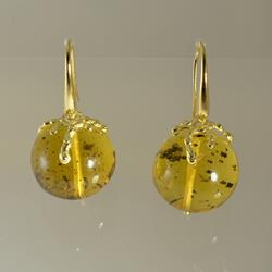 Gold earrings with amber spheres