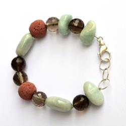Silver bracelet with brown and green hard stones