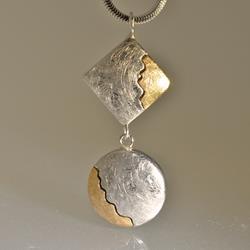 Ciondolo in argento e oro