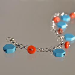 Silver bracelet with charms of coral and turquoise