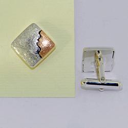 Gemelli in argento e oro