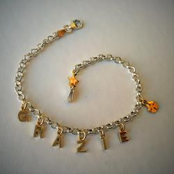 Silver bracelet with GRAZIE in gold charms